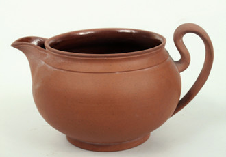 Jug from red-brown earthenware