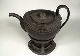 Teapot with stand for heating