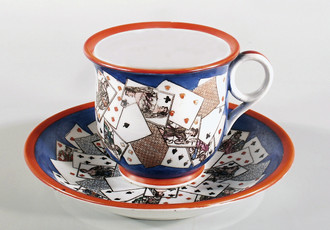 Cup and saucer with playing card motif