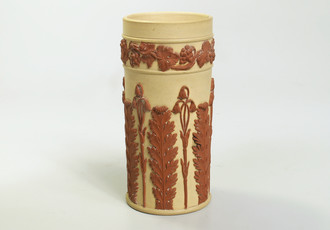 Cup with glued on appliqué