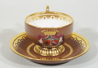 Cup and saucer with heraldic motif